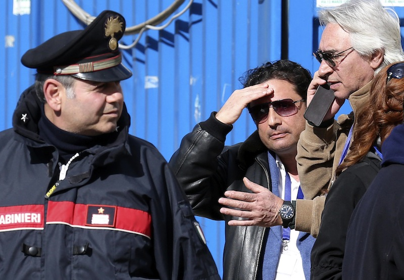 Schettino, the captain of the Costa Concordia, gestures after going back on board the cruise liner at Giglio harbour