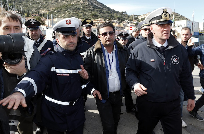 Schettino, the captain of the Costa Concordia, arrives after going back on board the cruise liner at Giglio harbour