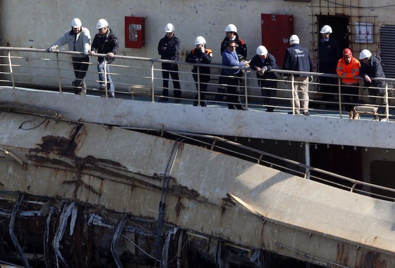The captain of the Costa Concordia, Francesco Schettino, stands on the Costa Concordia cruise liner at the Giglio harbour