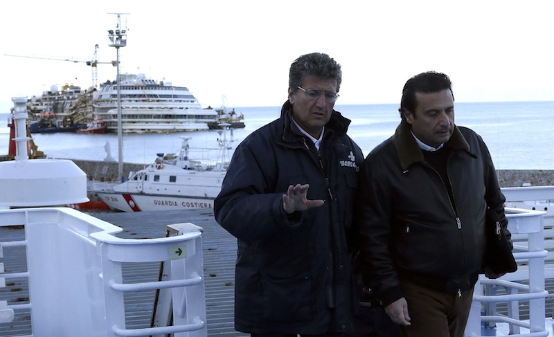Schettino, the captain of the Costa Concordia cruise liner, boards a ferry as he leaves Giglio harbour