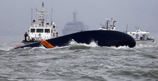 Vessels involved in salvage operations are seen near the upturned South Korean Sewol ferry in the sea off Jindo