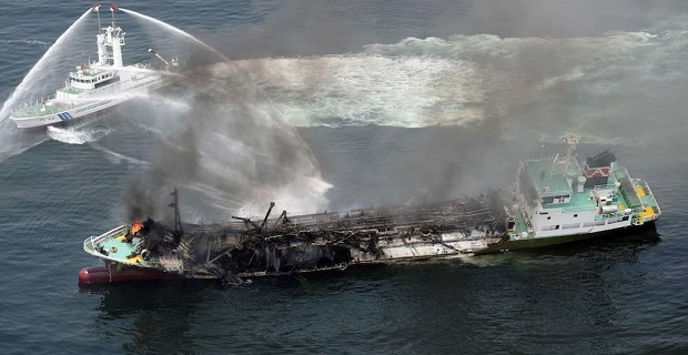 Smoke raises from the fuel tanker Shoko Maru after it exploded off the coast of Himeji, western Japan, in this photo taken by Kyodo
