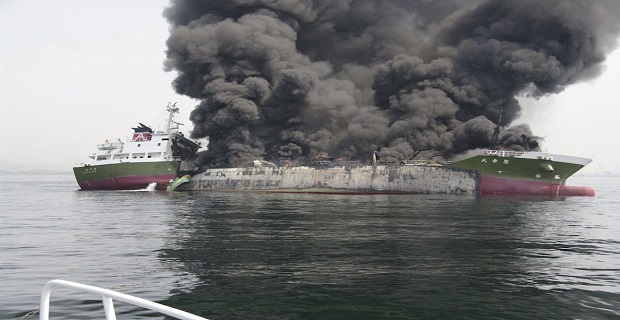 Smoke rises from the 998-tonne fuel tanker Shoko Maru after it exploded off the coast of Himeji