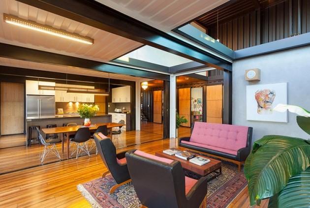 Στο σαλόνι και την τραπεζαρία τα κοντέινερ έχουν βαφτεί σε σκούρο χρώμα για πιο formal αποτέλεσμα.