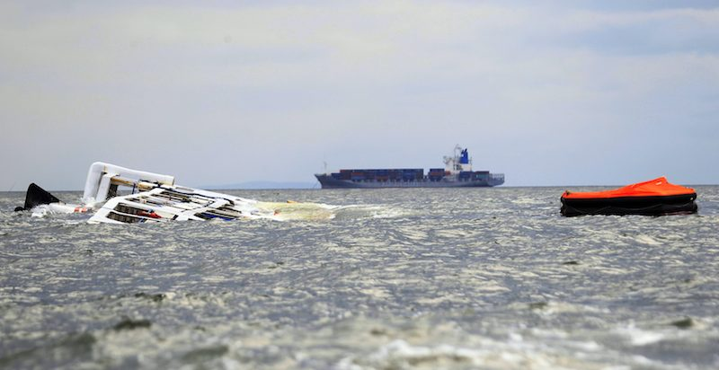The Super Shuttle Ferry 7 floats on its side after it capsized in strong winds and huge waves unleashed by Typhoon Kalmaegi, locally named Luis, in Manila Bay