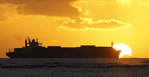 A cargo ship cruises as the sun sets at Ala Moana beach ahead of the APEC meeting in Honolulu