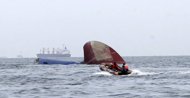 An Indonesia rescue team approaches the sunken Antigua and Barbuda flagged freighter MV Thorco Cloud which sank after colliding with a tanker the night before, in the Singapore Strait off the Indonesian island of Batam