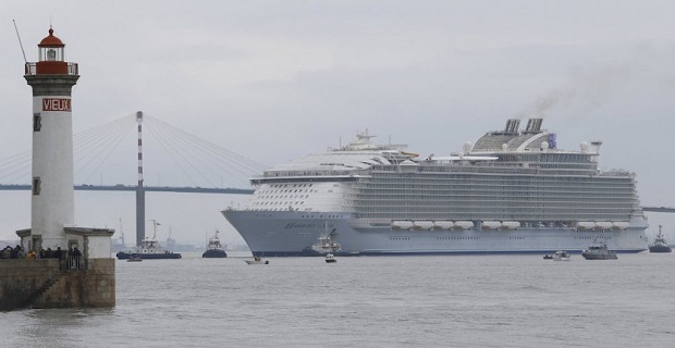 The Harmony of the Seas ( Oasis 3 ) class ship leaves the STX Les Chantiers de l'Atlantique shipyard site in Saint-Nazaire