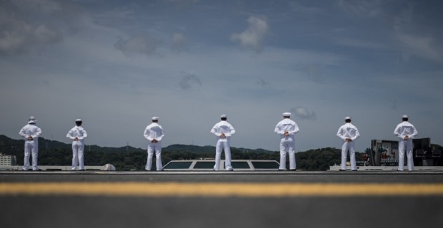 160604-N-IN729-098 YOKOSUKA, Japan (June 4, 2016) Sailors man the rails as the Navy's only forward-deployed aircraft carrier USS Ronald Reagan (CVN 76) departs Commander, Fleet Activities Yokosuka. Ronald Reagan provides a combat-ready force which protects and defends the collective maritime interests of the U.S. and its allies and partners in the Indo-Asia-Pacific region. (U.S. Navy photo by Mass Communication Specialist 3rd Class Ryan McFarlane/Released)