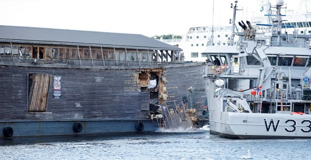 A full-size replica of the Ark of Noah is seen after it crashed into a moored coast guard vessel in Oslo harbour