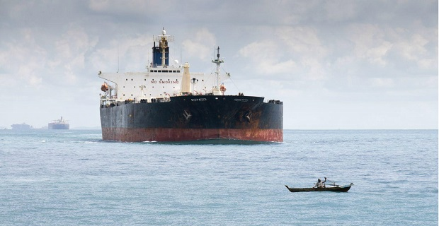 Tanker_ and_ small_ boat