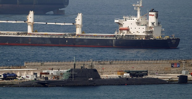 """A British nuclear Astute-class submarine HMS Ambush (Bottom) is seen docked in a port while it is repaired after it was involved in a """"glancing collision"""" with a merchant vessel off the coast of the peninsula of Gibraltar on Wednesday, in the British overseas territory of Gibraltar, July 21, 2016. REUTERS/Jon Nazca"""