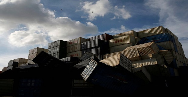 Birds fly over the toppled shipping containers after Typhoon Meranti made landfall, in Kaohsiung